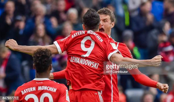 Bayern Munich's players celebrate after Polish striker Robert Lewandowski scored the 30 during the German First division Bundesliga football match FC...