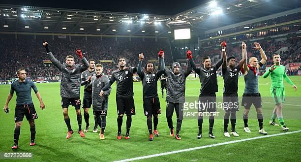 Bayern Munich's players celebrate after the German first division Bundesliga football match between FSV Mainz 05 and FC Bayern Munich in Mainz...
