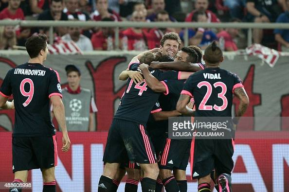 Bayern Munich's players celebrate their goal agianst Olympiakos during their Group F Champions League football match between Olympiakos and Bayern...