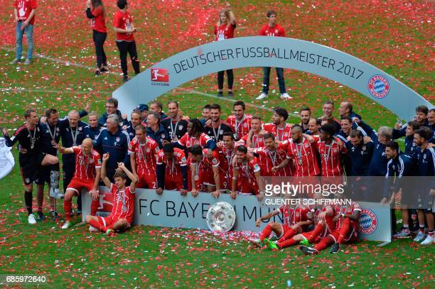 Bayern Munich's players celebrate with the trophy after the German first division Bundesliga football match FC Bayern Munich vs SC Freiburg his last...