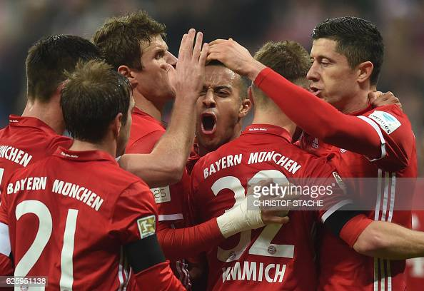 Bayern Munich's players celebrates scoring the opening goal during the German first division Bundesliga football match between FC Bayern Munich and...