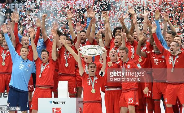 Bayern Munich's players celebrates winning their 25th Bundesliga title after German first division Bundesliga football match FC Bayern Munich vs 1...
