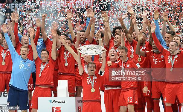 Bayern Munich's players celebrates winning their 25th Bundesliga title after German first division Bundesliga football match FC Bayern Munich vs 1...