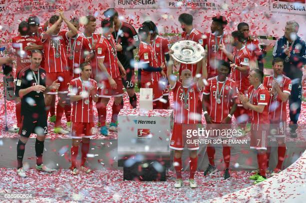 Bayern Munich's players including Bayern Munich's Dutch midfielder Arjen Robben celebrate with the trophy after the German first division Bundesliga...