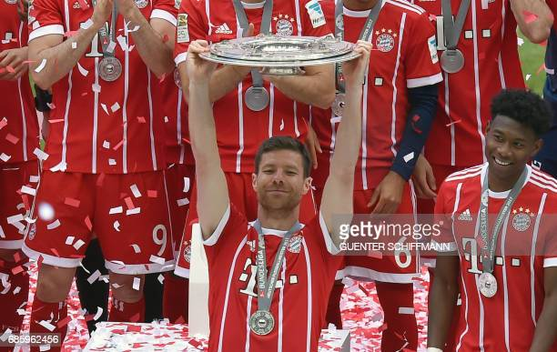 Bayern Munich's players including Bayern Munich's Spanish midfielder Xabi Alonso celebrate with the trophy after the German first division Bundesliga...