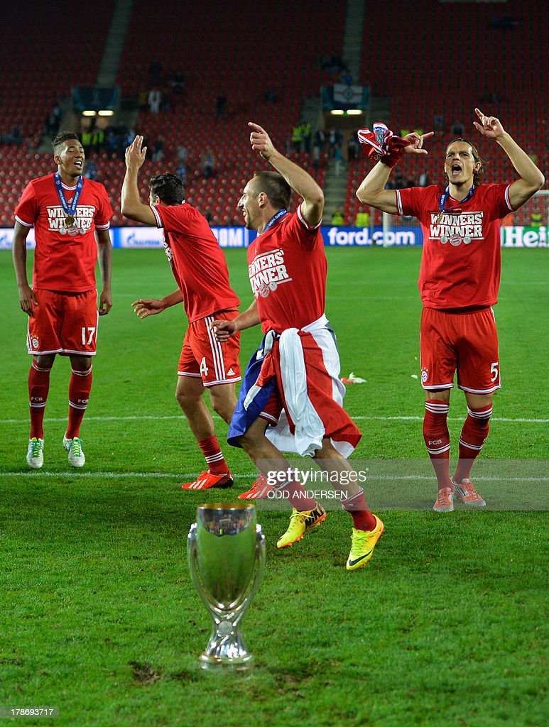Bayern Munich's players including (from L) defender Jerome Boateng, Peruvian striker Claudio Pizarro, French midfielder Franck Ribery and Belgian defender Daniel van Buyten celebrate with the trophy after the UEFA Super Cup football match FC Bayern Munich vs Chelsea FC on August 30, 2013 at the Eden Stadium, in Prague.