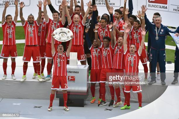 Bayern Munich's players including defender Philipp Lahm celebrate with the trophy after the German first division Bundesliga football match FC Bayern...