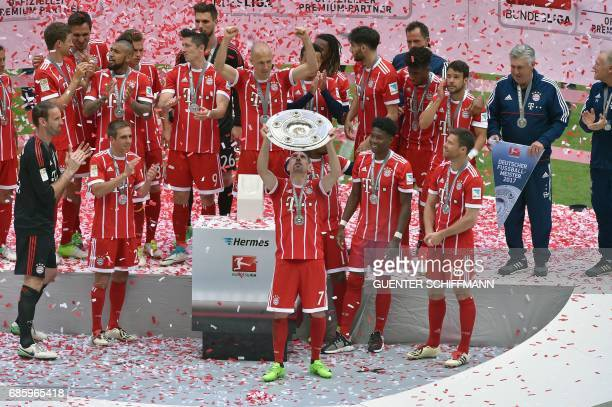 Bayern Munich's players including French midfielder Franck Ribery celebrate with the trophy after the German first division Bundesliga football match...