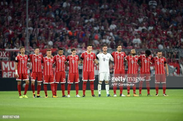 Bayern Munich's players observe a minutes' silence for the victims of the attack in Barcelona prior to the German First division Bundesliga football...