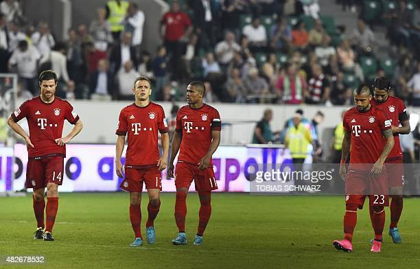 Bayern Munich's players react after the penalties of the German Super Cup football match VfL Wolfsburg vs Bayern Munich in Wolfsburg central Germany...