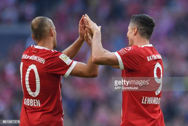 Bayern Munich's Polish forward Robert Lewandowski and Bayern Munich's Dutch midfielder Arjen Robben celebrate after a goal during the German First...