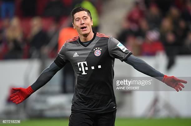 Bayern Munich's Polish forward Robert Lewandowski celebrate scoring during the German first division Bundesliga football match between FSV Mainz 05...