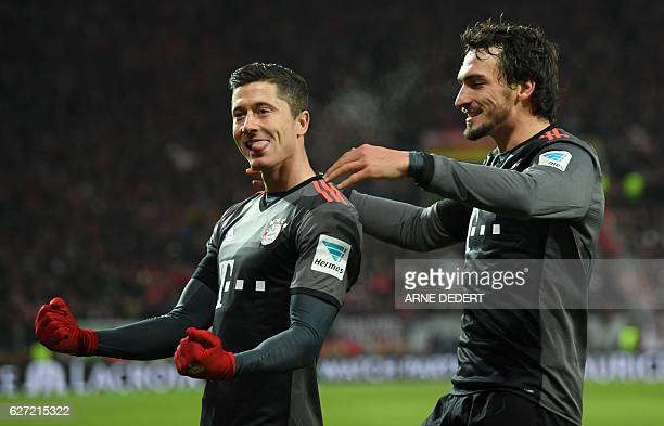Bayern Munich's Polish forward Robert Lewandowski celebrate scoring with Bayern Munich's defender Mats Hummels during the German first division...