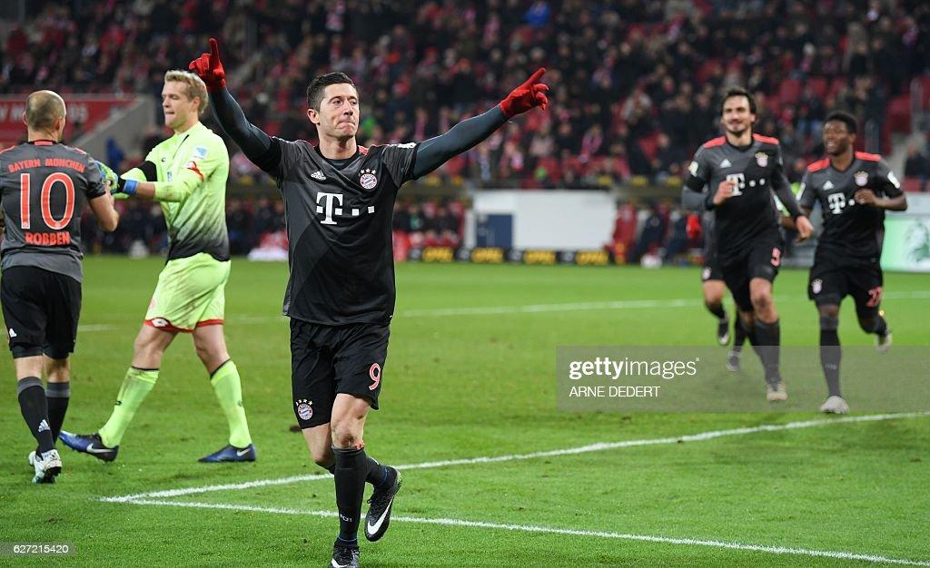 Bayern Munich's Polish forward Robert Lewandowski celebrate scoring during the German first division Bundesliga football match between FSV Mainz 05 and FC Bayern Munich in Mainz, southern Germany on December 2, 2016. / AFP / dpa / Arne Dedert / NO Getty Images (GETTY-VD) - Germany