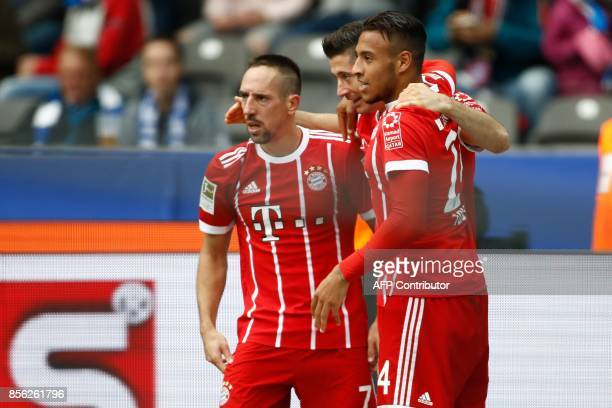 Bayern Munich's Polish forward Robert Lewandowski celebrate scoring the 02 goal with his teammates French midfielder Franck Ribery and Bayern...