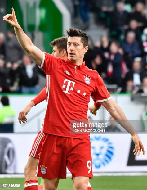 Bayern Munich's Polish forward Robert Lewandowski celebrates after scoring the 20 during the German first division Bundesliga football match between...