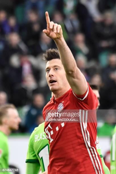 Bayern Munich's Polish forward Robert Lewandowski celebrates after scoring the 30 during the German first division Bundesliga football match between...