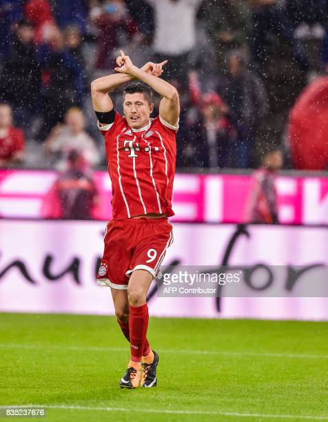 Bayern Munich's Polish forward Robert Lewandowski celebrates scoring from the penalty spot during the German First division Bundesliga football match...