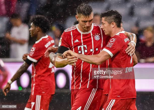 Bayern Munich's Polish forward Robert Lewandowski celebrates scoring from the penalty spot with his teammates during the German First division...