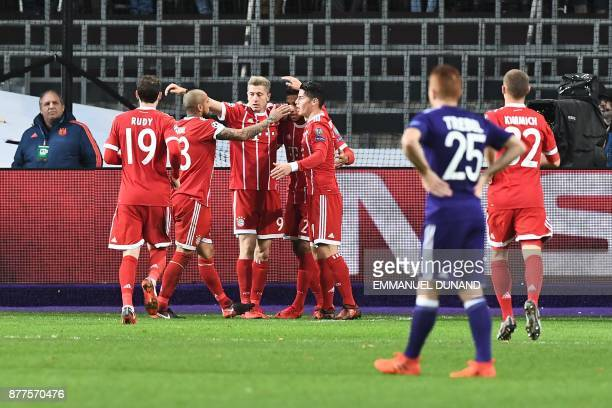 Bayern Munich's Polish forward Robert Lewandowski celebrates with teammates after scoring a goal during the UEFA Champions League Group B football...