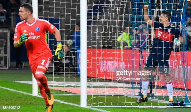 Bayern Munich's Polish forward Robert Lewandowski ends up in the Hamburg goal after failing to score during the German first division Bundesliga...