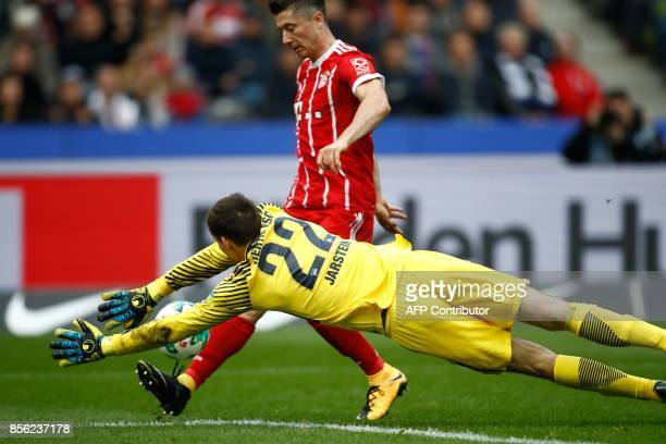 TOPSHOT Bayern Munich's Polish forward Robert Lewandowski fails to score past Berlin's Norwegian goalkeeper Rune Jarstein during the German first...