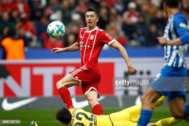 Bayern Munich's Polish forward Robert Lewandowski fails to score past Berlin's Norwegian goalkeeper Rune Jarstein during the German first division...