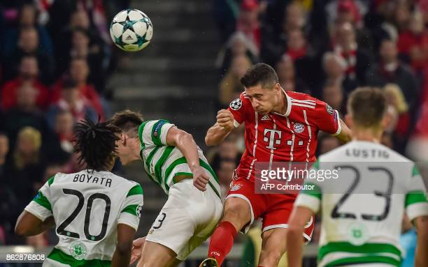 Bayern Munich's Polish forward Robert Lewandowski heads the ball during the Champions League group B match between FC Bayern Munich and Celtic...