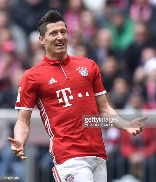 Bayern Munich's Polish forward Robert Lewandowski reacts during the German first division Bundesliga football match between FC Bayern Munich and...