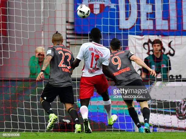 Bayern Munich's Polish forward Robert Lewandowski scores Bayern's third goal during the German first division Bundesliga football match between RB...