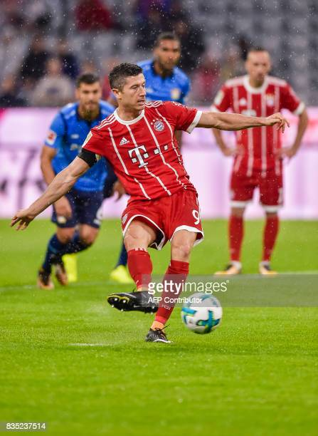 Bayern Munich's Polish forward Robert Lewandowski scores from the penalty spot during the German First division Bundesliga football match FC Bayern...