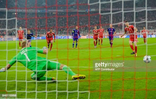 Bayern Munich's Polish forward Robert Lewandowski scores the penalty during the Champions League group B match between Bayern Munich and RSC...