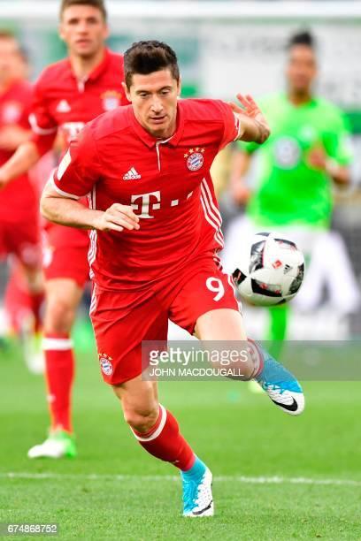 Bayern Munich's Polish forward Robert Lewandowski vies for the ball during the German first division Bundesliga football match between VfL Wolfsburg...