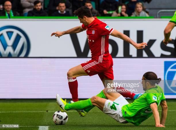 Bayern Munich's Polish forward Robert Lewandowski vies with Wolfsburg's Swiss defender Ricardo Rodriguez during the German first division Bundesliga...