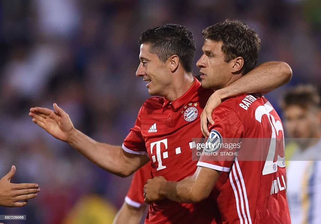 Bayern Munich's Polish striker Robert Lewandowski and Bayern Munich's striker Thomas Mueller celebrate after the first goal for Munich during the...