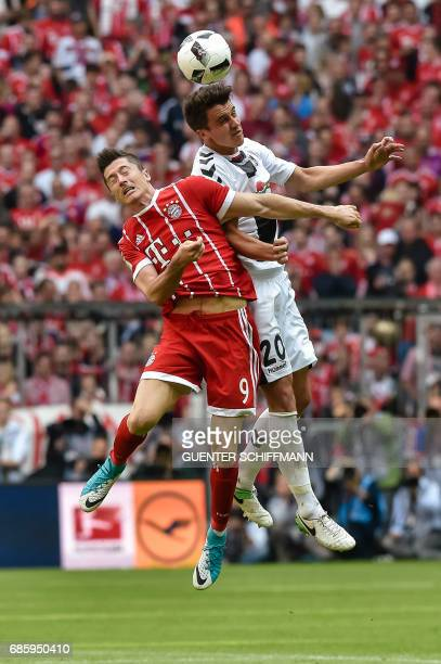 Bayern Munich's Polish striker Robert Lewandowski and Freiburg's German defender MarcOliver Kempf vie for the ball during the German first division...