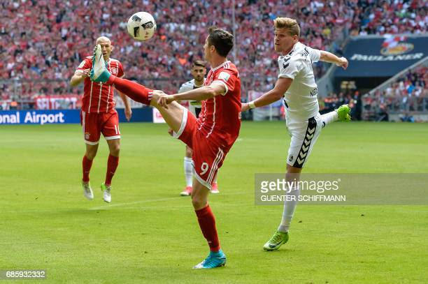 Bayern Munich's Polish striker Robert Lewandowski and Freiburg's forward Florian Niederlechner vie for the ball during the German First division...