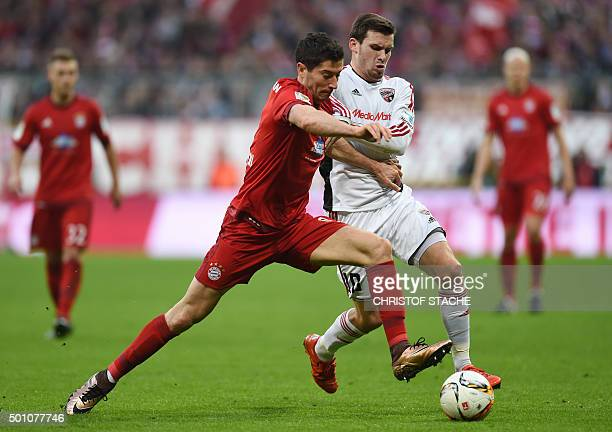 Bayern Munich's Polish striker Robert Lewandowski and Ingolstadt's midfielder Pascal Gross vie for the ball during the German first division...