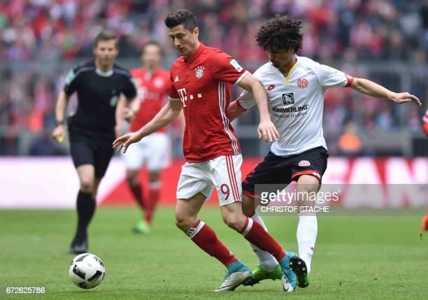 Bayern Munich's Polish striker Robert Lewandowski and Mainz's Italian defender Giulio Donati vie for the ball during the German first division...