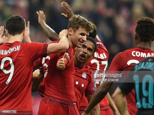 Bayern Munich's Polish striker Robert Lewandowski Bayern Munich's striker Thomas Mueller and Bayern Munich's Brazilian midfielder Douglas Costa...