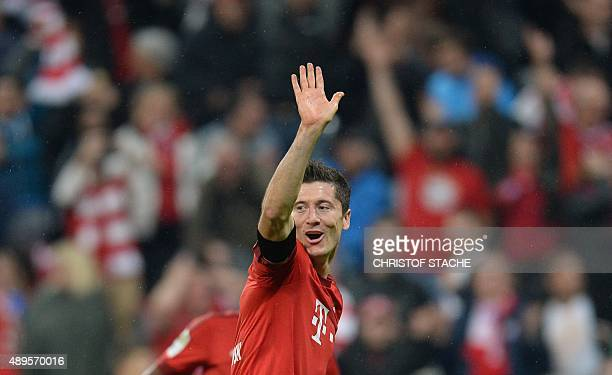 Bayern Munich's Polish striker Robert Lewandowski celebrates after his fifth goal for Munich during the German first division Bundesliga football...