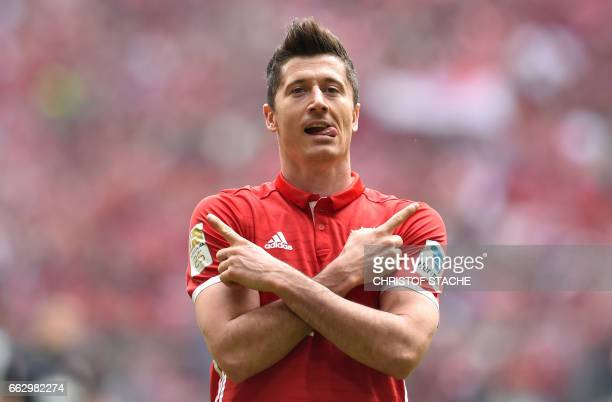Bayern Munich's Polish striker Robert Lewandowski celebrates after scoring the 10 during the German first division Bundesliga football match between...