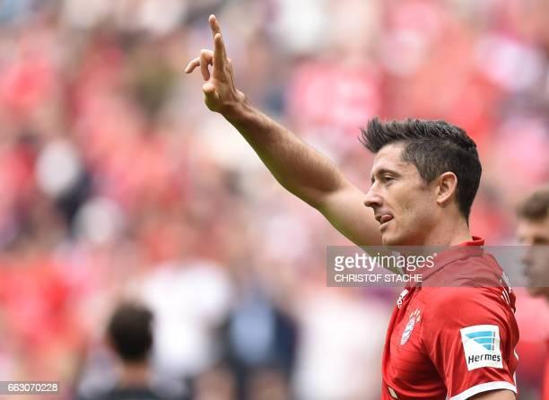 Bayern Munich's Polish striker Robert Lewandowski celebrates after scoring the 50 his third during the German first division Bundesliga football...
