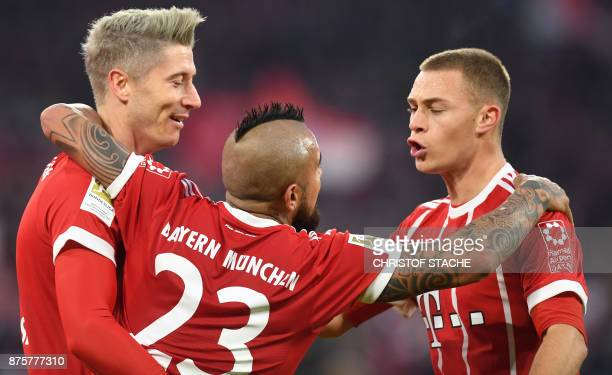 Bayern Munich's Polish striker Robert Lewandowski celebrates after scoring the second goal for Munich with Bayern Munich's Chilean midfielder Arturo...