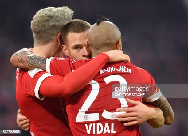 Bayern Munich's Polish striker Robert Lewandowski celebrates after scoring the second goal for Munich with Bayern Munich's midfielder Joshua Kimmich...