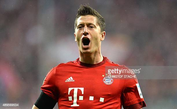 Bayern Munich's Polish striker Robert Lewandowski celebrates after the third goal for Munich during the German first division Bundesliga football...
