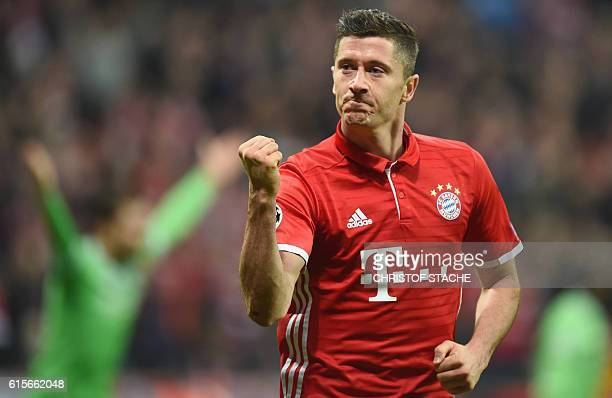 Bayern Munich's Polish striker Robert Lewandowski celebrates after the third goal for Munich during the UEFA Champions League group D football match...