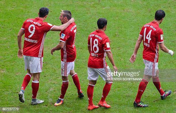Bayern Munich's Polish striker Robert Lewandowski celebrates his goal with Bayern Munich's French midfielder Franck Ribery during the German first...