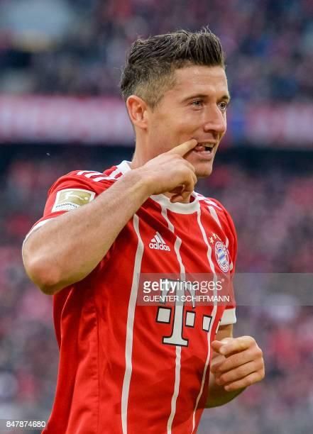 Bayern Munich's Polish striker Robert Lewandowski celebrates his second goal during the German First division Bundesliga football match FC Bayern...