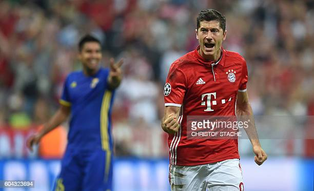 Bayern Munich's Polish striker Robert Lewandowski celebrates scoring the opening goal from the penalty spot during the Champions League group D...